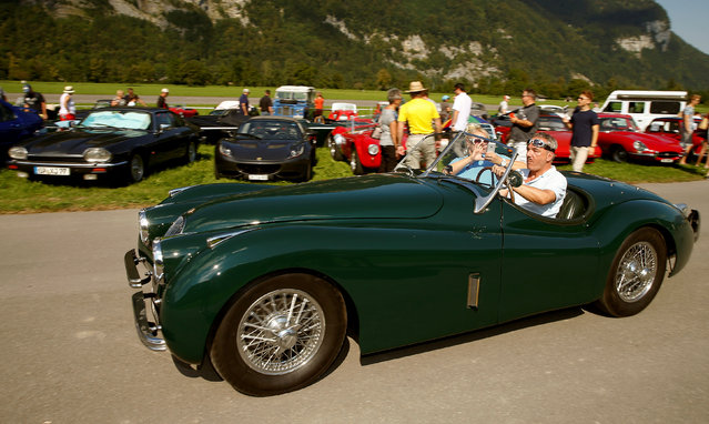 A participant drives his vintage Jaguar XK 120 sports car during the British Car Meeting 2016 in the village of Mollis, Switzerland August 28, 2016. (Photo by Arnd Wiegmann/Reuters)
