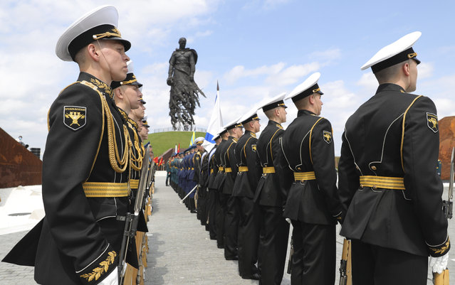 Russian sailors attend an opening ceremony of the monument to honour the World War II Red Army, in the village of Khoroshevo, just outside Rzhev, about 200 kilometers (about 125 miles) northwest of Moscow, Russia, Tuesday, June 30, 2020. Putin urged voters to cast ballots in a constitutional vote wrapping up Wednesday that could allow him to extend his rule until 2036. (Photo by Mikhail Klimentyev, Sputnik, Kremlin Pool Photo via AP Photo)