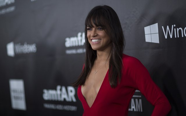 Actress Michelle Rodriguez poses at amfAR's Fifth Annual Inspiration Gala in Los Angeles, California October 29, 2014. (Photo by Mario Anzuoni/Reuters)