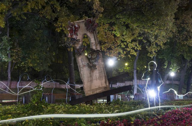 A piece of the Berlin Wall is seen in a park in central Moscow October 8, 2014. (Photo by Maxim Shemetov/Reuters)