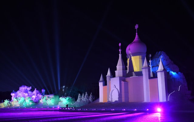 Photo taken on January 3, 2018 shows the snow-light show at the Sun Island International Snow Sculpture Art Expo in Harbin, capital of northeast China's Heilongjiang Province. Snow Wonderland, a 3D snow-light show applying modern sound, light and digital technologies has been displayed at Sun Island International Snow Sculpture Art Expo recent days. (Photo by Wang Jianwei/Xinhua via Getty Images)