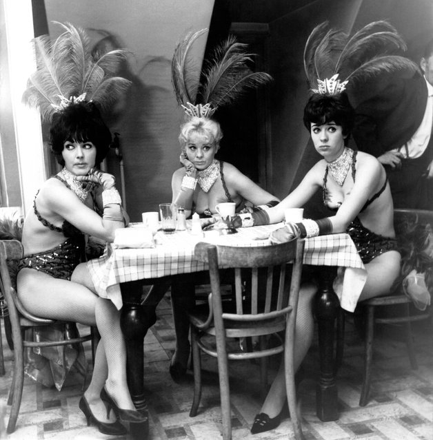 Three cabaret dancers sit glum-faced in the Windmill Theatre's canteen upon hearing the news that the theatre's owners have sold out to a cinema company, on October 02, 1964. The theatre, which was the first to include nudity in its shows, has been able to cope with competition from a growing number of West End strip clubs. (Photo by Hulton-Deutsch Collection/CORBIS/Corbis via Getty Images)