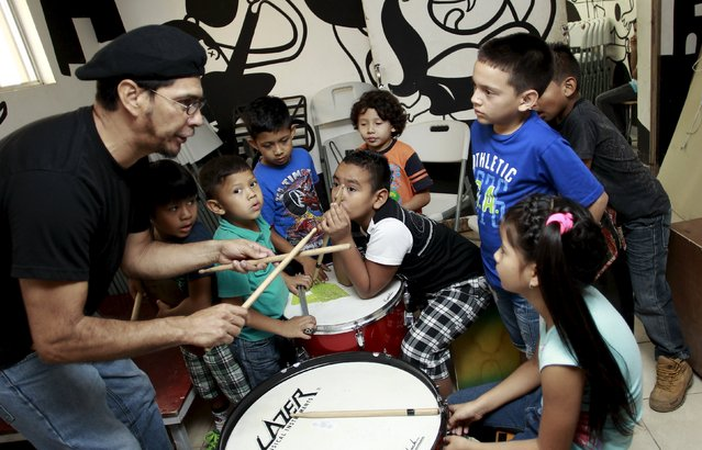 Children attend a drum lesson at the Integral System of Artistic Education for Social Inclusion (SIFAIS) center in the poor neighborhood of La Carpio, Costa Rica August 29, 2015. (Photo by Juan Carlos Ulate/Reuters)