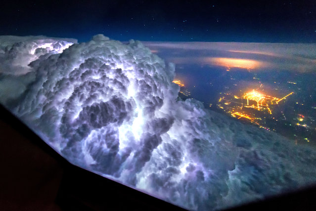 Thunderstorms light up the insides of clouds. (Photo by Christiaan van Heijst/Daan Krans/Caters News Agency)