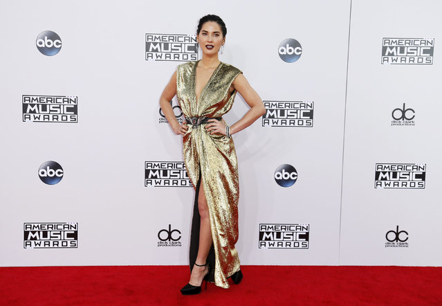 Actress Olivia Munn arrives at the 42nd American Music Awards in Los Angeles. (Photo by Danny Moloshok/Reuters)