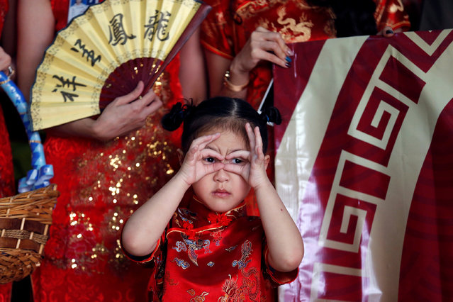 A girl is dressed in traditional Chinese clothing during a lunar new year welcome ceremony for Chinese tourists at Don Mueang international airport in Bangkok, Thailand on February 16, 2018. (Photo by Soe Zeya Tun/Reuters)