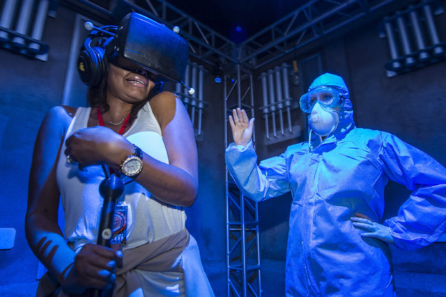 "In this September 27, 2016 photo released by Universal Orlando, an unidentified woman, left, experiences the new immersive interactive experience, ""The Repository"", at Universal Orlando Resort in Orlando, Fla. ""The Repository"" attraction is available on select nights through Oct. 31. (Photo by Octavian Cantilli/Universal Orlando via AP Photo)"
