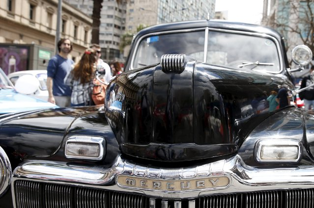 "People observe a 1947 Mercury during the 25th edition of the ""1000 millas sport e historicos"" (1000 miles sports and classic) race in Montevideo, October 28, 2015. (Photo by Andres Stapff/Reuters)"