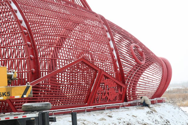 World's largest 40-meter-long steel carp with the height of 13 meters and the width of 10 meters is seen on December 4, 2014 in Harbin, Heilongjiang province of China. World's largest steel carp was built at Harbin ice and snow world on Thursday. (Photo by ChinaFotoPress/Getty Images)