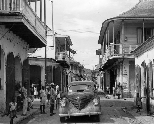 A busy residential street with an unmetalled road in Cap Hatien, Haiti, circa 1940. (Photo by Herbert C. Lanks/Three Lions/Getty Images)