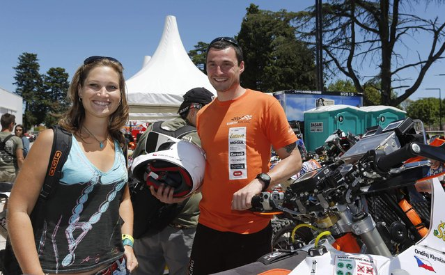 KTM rider Ondrej Klymciw of Czech Republic and his girlfriend Radka Navarova await technical verification ahead of the Dakar Rally 2015 in Buenos Aires January 2, 2015. (Photo by Enrique Marcarian/Reuters)