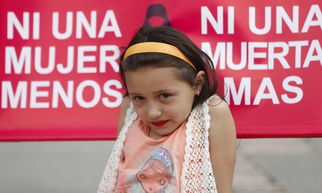 A child is seen during a march to commemorate International Day for the Elimination of Violence Against Women, in Bogota, November 25, 2015. (Photo by John Vizcaino/Reuters)