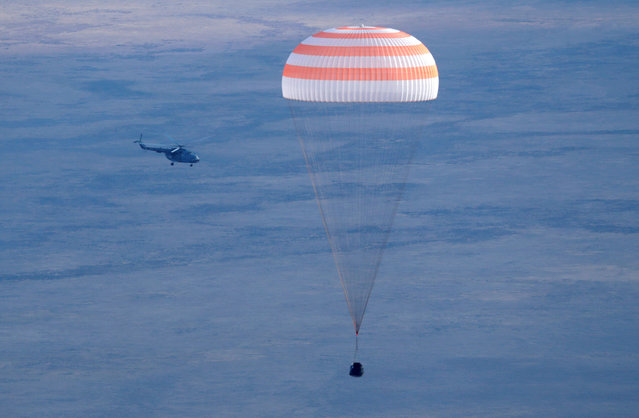 In this photo provided by NASA, the Soyuz MS-01 spacecraft is seen as it lands with NASA astronaut Kate Rubins, Russian cosmonaut Anatoly Ivanishin of Roscosmos, and astronaut Takuya Onishi of the Japan Aerospace Exploration Agency (JAXA) near the town of Zhezkazgan, Kazakhstan on Sunday, October 30, 2016. A Russian Soyuz space capsule has landed in Kazakhstan, bringing back three astronauts from the United States, Japan and Russia back to Earth from a 115-day mission aboard the International Space Station. (Photo by Dmitri Lovetsky/Reuters)