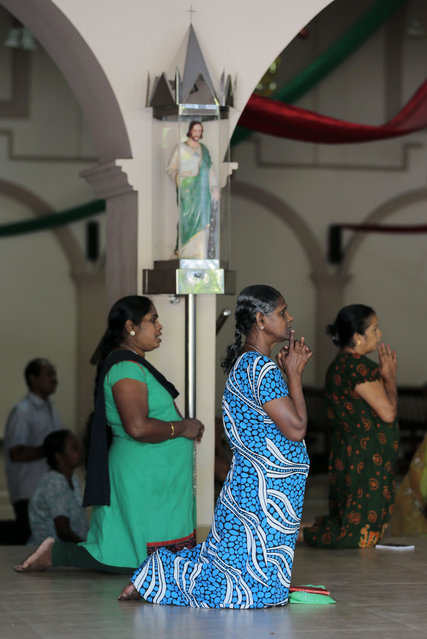 In this Wednesday, January 7, 2015 photo, Sri Lankan Catholic women pray at a church in Colombo, Sri Lanka. (Photo by Eranga Jayawardena/AP Photo)