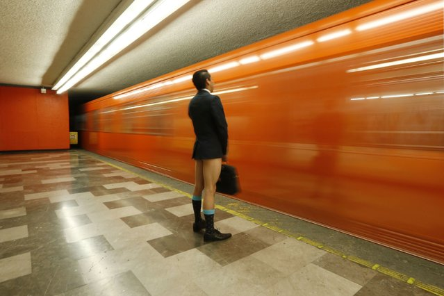 "A passenger without pants waits for the subway train during ""The No Pants Subway Ride"" in Mexico City January 11, 2015. (Photo by Edgard Garrido/Reuters)"