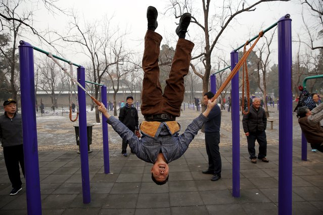 Elderly people exercise in a park on a heavily polluted morning in Beijing, China, November 29, 2015. Beijing plans to ramp up its already tough car emission standards by 2017 in a bid by one of the world's most polluted cities to improve its often hazardous air quality. (Photo by Damir Sagolj/Reuters)