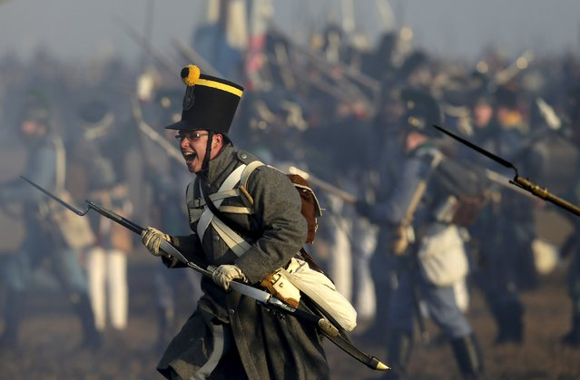 A history enthusiast, dressed as a soldier, fights during the re-enactment of Napoleon's famous battle of Austerlitz near the southern Moravian town of Slavkov u Brna December 5, 2015. (Photo by David W. Cerny/Reuters)