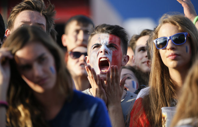 A French fan reacts during the Russia 2018 World Cup Group C football match between France and Peru at the Ekaterinburg Arena in Ekaterinburg on June 21, 2018. (Photo by Gleb Garanich/Reuters)