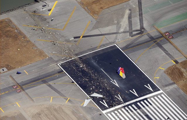 A close up of the runway and debris of a Boeing 777 airplane that burned on the runway after it crash landed at San Francisco International Airport July 6, 2013 in San Francisco, California. An Asiana Airlines passenger aircraft coming from Seoul, South Korea crashed while landing. There has been at least two casualties reported. (Photo by Ezra Shaw/Getty Images)