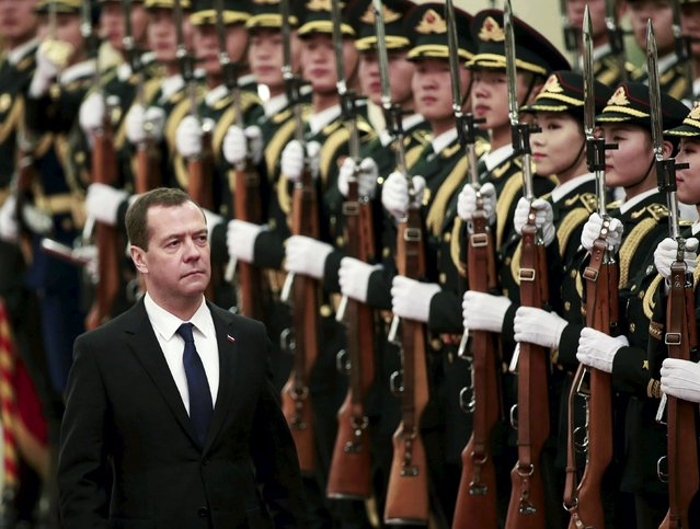 Russian Prime Minister Dmitry Medvedev inspects honour guards during a welcoming ceremony at the Great Hall of the People in Beijing, China, December 17, 2015. (Photo by Kim Kyung-Hoon/Reuters)