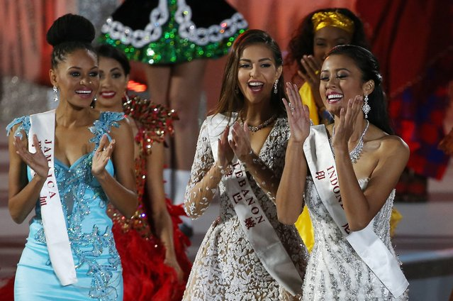 Miss Indonesia, Maria Harfanti (R) reacts after she was announced second runner-up for the Miss World title during the grand final of the 65th Miss World pageant at the Beauty Crown Hotel Complex in Sanya, Hainan province, China, 19 December 2015. (Photo by How Hwee Young/EPA)