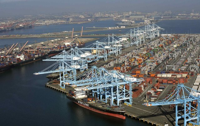Cranes stand idle in the ports of Los Angeles and Long Beach, California in this aerial photo taken February 6, 2015. (Photo by Bob Riha, Jr./Reuters)