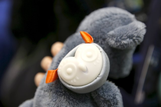 """An Oliba is shown attached to a teddy bear during """"CES Unveiled,"""" a preview event of the 2016 International CES trade show, in Las Vegas, Nevada January 4, 2016. The $69.00 smart toy tracker from France can also be programed to play stories or sing a lullaby. (Photo by Steve Marcus/Reuters)"""