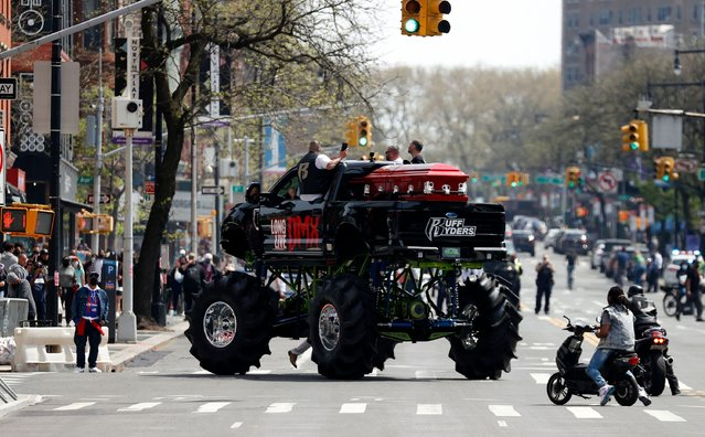 The casket of US rapper is seen on a monster truck on Flatbush avenue outside the Barclays Center where a private memorial for US rapper DMX is being held in Brooklyn, New York, USA, 24 April 2021. DMX died at the age of 50, after he was admitted to the hospital for a heart attack where he remained on life support until 09 April 2021. (Photo by Jason Szenes/EPA/EFE)