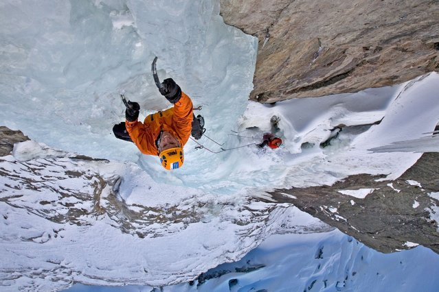 These daring climbers kept their cool as they scaled a frozen waterfall a staggering 7,200 feet up in the Alps, on October 4, 2013. (Photo by Photoshelter)