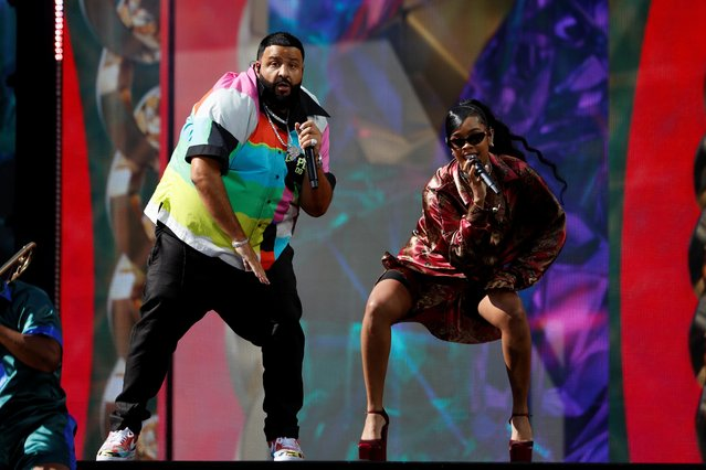 DJ Khaled and American singer and songwriter H.E.R perform at the 2021 Billboard Music Awards outside the Microsoft Theater in Los Angeles, California, U.S., May 23, 2021. (Photo by Mario Anzuoni/Reuters)