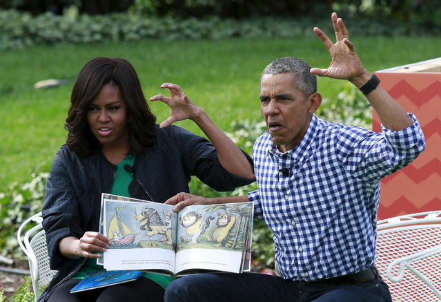 """President Barack Obama and first lady Michelle Obama perform a reading of the children's book """"Where the Wild Things Are"""" for children gathered for the annual White House Easter Egg Roll on the South Lawn of the White House in Washington, March 28, 2016. (Photo by Yuri Gripas/Reuters)"""