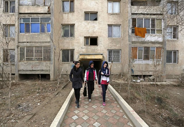 Zhala (L), Maryam Sediqi (C) and Malika Yousufi (R), members of Afghanistan's Women's National Cycling Team walk in Kabul February 20, 2015. (Photo by Mohammad Ismail/Reuters)