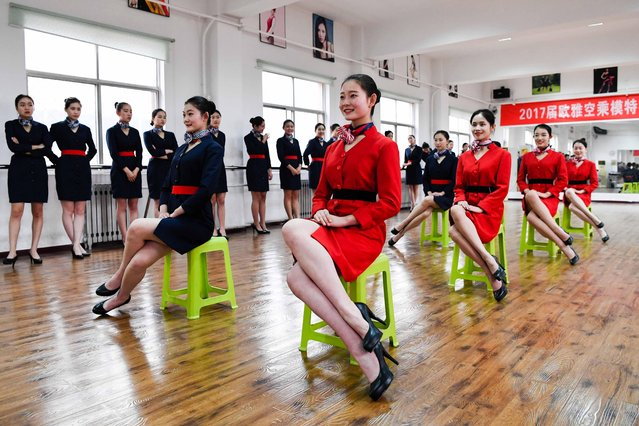 Students attend a stewardess skill training for the upcoming 2017 entrance examination for art majors in colleges in Luoyang, central China's Henan Province, January 4, 2017. Along with how to stand, how to sit is also covered in these classes. (Photo by Li Bo/Xinhua/Barcroft Images)