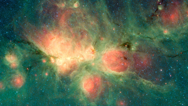 The Cat's Paw Nebula, a star-forming region in the Milky Way galaxy so named because it resembles a feline footprint, is seen in this image compiled from data from the Infrared Array Camera (IRAC) and the Multiband Imaging Photometer (MIPS) aboard the infrared Spitzer Space Telescope, obtained November 16, 2018. (Photo by NASA/Spitzer Space Telescope/Handout via Reuters)
