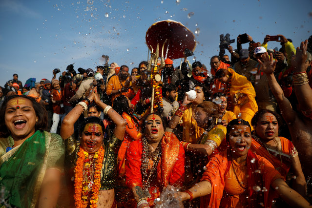 """Lakshmi Narayan Tripathi (C), chief of the """"Kinnar Akhada"""" congregation for transgender people and other members take a dip during the first """"Shahi Snan"""" (grand bath) at """"Kumbh Mela"""" or the Pitcher Festival, in Prayagraj, previously known as Allahabad, India, January 15, 2019. (Photo by Danish Siddiqui/Reuters)"""