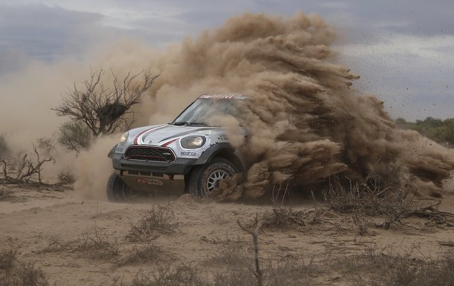 Driver Orlando Terranova of Argentina and co-driver Andreas Schulz of Germany race their Mini during the 11th stage of the Dakar Rally, between San Juan and Rio Cuarto, Argentina, Friday, January 13, 2017. (Photo by Martin Mejia/AP Photo)