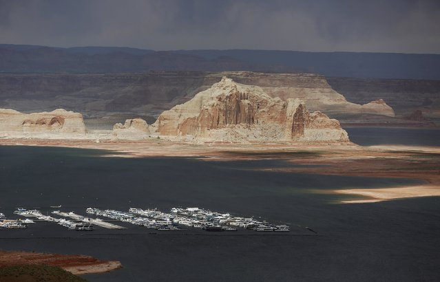 Boats can be seen with low water levels of the Colorado River fed Lake Powell outside Page, Arizona, April, 14, 2015. (Photo by Jim Urquhart/Reuters)