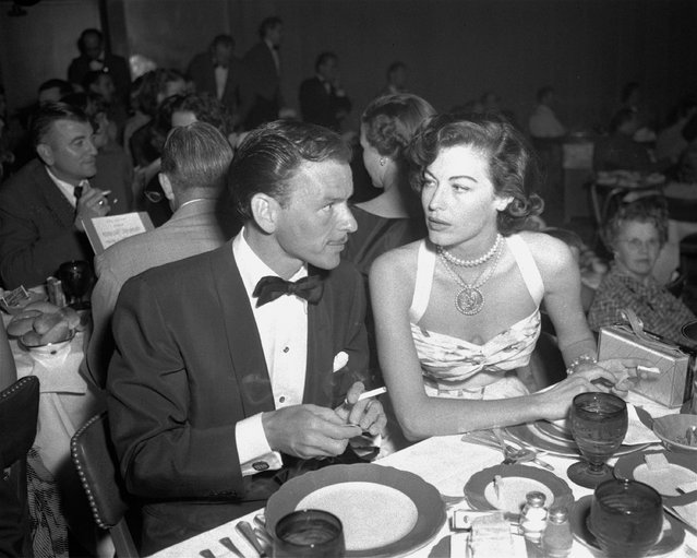 In this August 19, 1951 file photo, singer Frank Sinatra and Ava Gardner hold cigarettes as they dine together at the Riverside Hotel in Reno, Nev. (Photo by AP Photo)