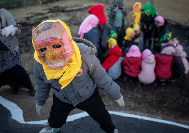 """Costumed children from the local Shade performance group perform their show during the annual Brixton Burn in Johannesburg, South Africa, 28 August 2021. The annual event is run by members of the """"Afrikaburn"""" community which is a regional event of """"Burning Man"""" in the United States. (Photo by Kim Ludbrook/EPA/EFE)"""