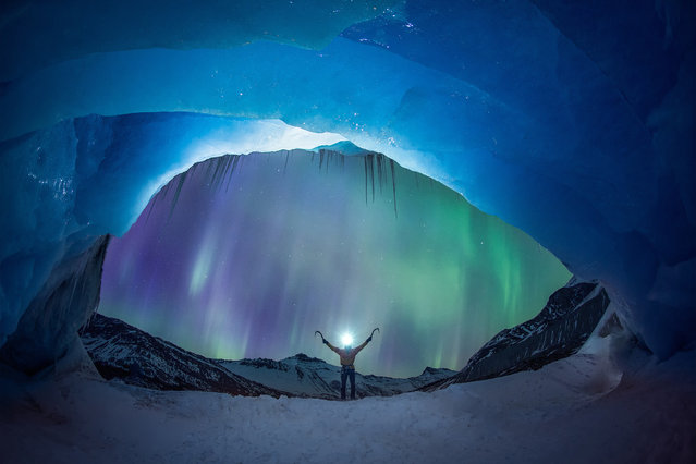 A pair of ice climbers have been snapped in front of a stunning aurora. Mike Stuart and Takeshi Tani were climbing the Athabasca Glacier in Alberta, Canada, when the aurora lit up the nights sky. They were photographed by famed night-time photographer Paul Zizka, who specialises in photographing auroras in some of Canadas most beautiful parks. (Photo by Paul Zizka/Caters News)
