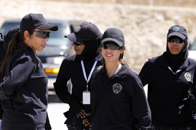Members of the Jordanian women's police special operations team wait to compete during the 7th Annual International Warrior Competition hosted by the King Abdullah Special Operations Training Center (KASOTC), Sunday, April 19, 2015, Amman, Jordan. (Photo by Raad Adayleh/AP Photo)