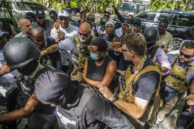 Martine Moise, the widow of slain President Jovenel Moise, center, arrives to the courthouse to give testimony in the ongoing investigation into the assassination of her husband in Port-au-Prince, Haiti, Wednesday, October 6, 2021. (Photo by Joseph Odelyn/AP Photo)