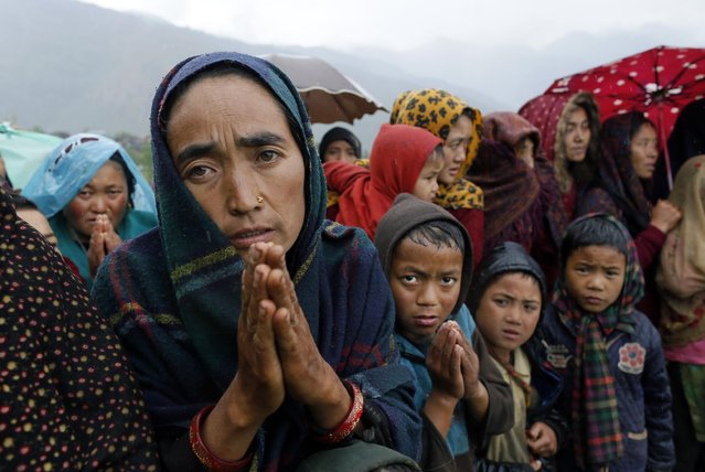 Ramaya pleads for food after an aid relief helicopter lands at the remote mountain village of Gumda, near the epicenter of Saturday's massive earthquake in the Gorkha District of Nepal, Wednesday, April 29, 2015. Aid reached the hilly district for the first time Wednesday, four days after the quake struck. (Photo by Wally Santana/AP Photo)