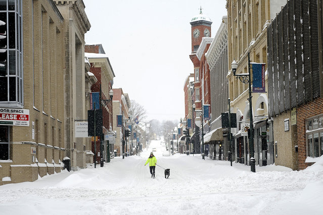 Gerry Stowers walks her dog, Jane Rambo, down the middle of Beverley Street after a snowstorm accumulating over a foot of snow fell in Staunton, Virginia. (Photo by Katie Currid/The News Leader)