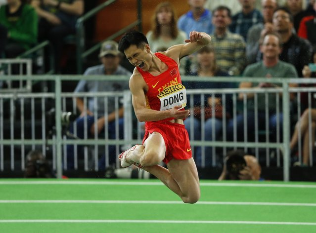 Dong Bin of China celebrates winning the gold medal in the men's triple jump during the IAAF World Indoor Athletics Championships in Portland, Oregon March 19, 2016. (Photo by Mike Blake/Reuters)