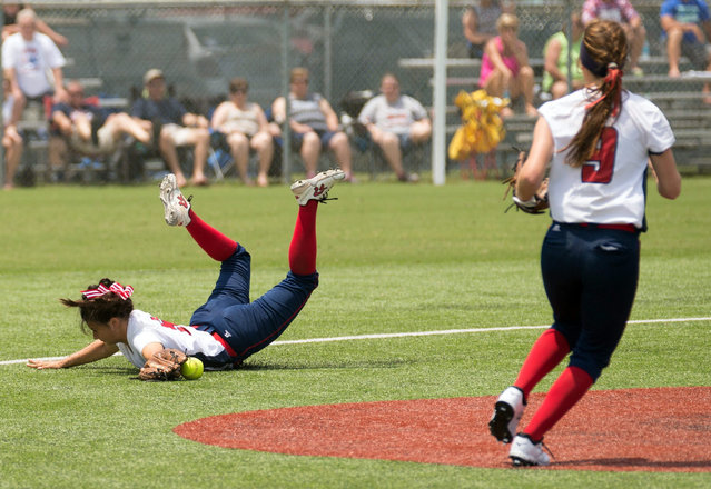Shelby Breaux of North Vermillion dives to keep a ball from getting past the infield against John Curtis during the Class 3A LHSAA FastPitch 56 softball tournament at Frasch Park in Sulphur, La. on Saturday, May 2, 2015.  (Photo by Kirk Meche/The American Press via AP Photo)