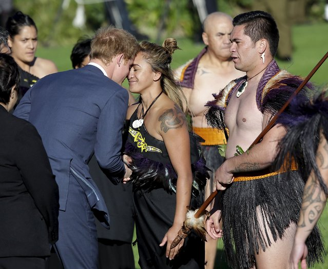 Britain's Prince Harry receives a hongi (traditional Maori greeting) from a Maori woman during his official welcome at the Government House in Wellington, May 9, 2015. Harry is starting a week-long tour of New Zealand. (Photo by Anthony Phelps/Reuters)