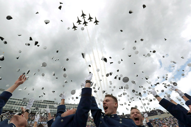 U.S. Air Force Academy graduating cadets toss their caps as Thunderbirds perform a flyover at the conclusion of the U.S. Air Force Academy's graduation ceremony in Colorado Springs, Colorado, U.S., May 30, 2019. (Photo by Jonathan Ernst/Reuters)