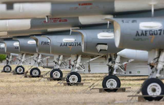 F-16 Fighting Falcons sit in a field along Miami St. at the 309th Aerospace Maintenance and Regeneration Group boneyard, Thursday, May 21, 2015 at Davis-Monthan Air Force Base in Tucson, Ariz. Over 4,500 variants of the F-16's have been produced since 1973. This field of fighters will become drone target planes in the future. (Photo by Matt York/AP Photo)