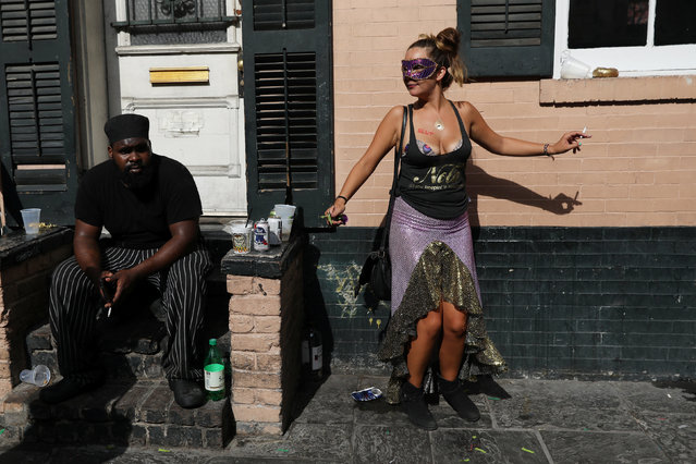 A woman dances during Mardi Gras celebration at the French Quarter in New Orleans, Louisiana U.S., February 28, 2017. (Photo by Shannon Stapleton/Reuters)
